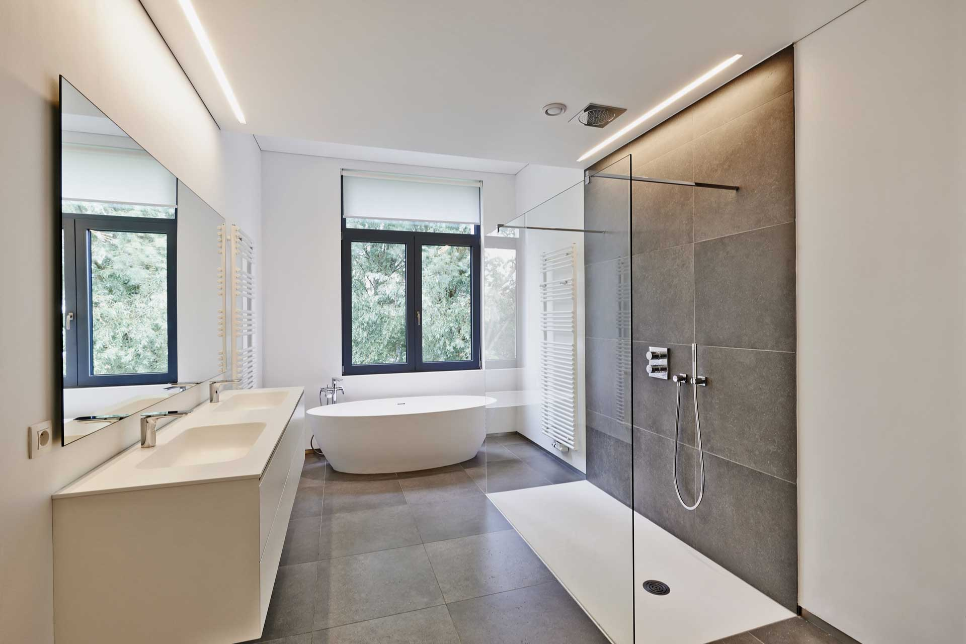 stock-photo-interior-of-fancy-bathroom-in-black-color-with-shiny-metal-freestanding-bath-near-wide-window-664737463
